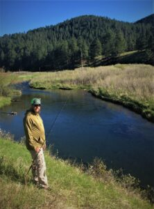 The author's brother Ben Simonson of Valley City, ND helps him scout a pool on a small stream in the Black Hills of South Dakota. Simonson Photo.